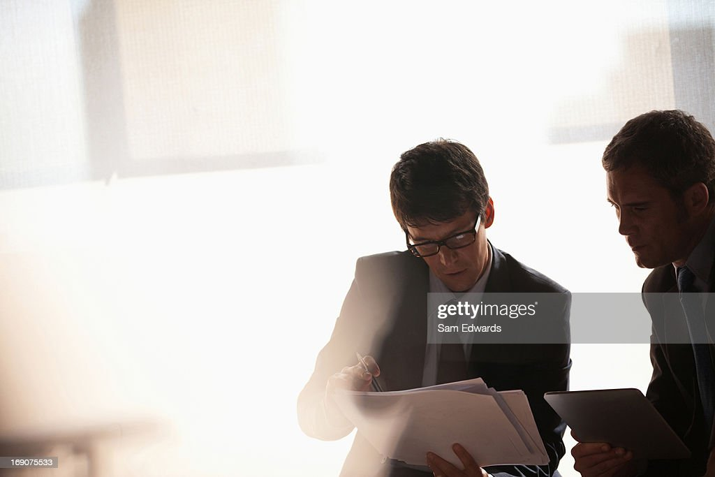 Businessmen working together : Stock Photo