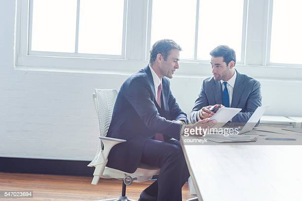 2 businessmen working with technology.