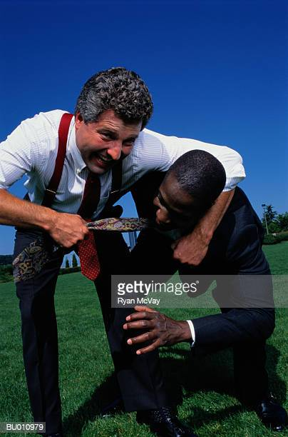 Businessmen Wrestling