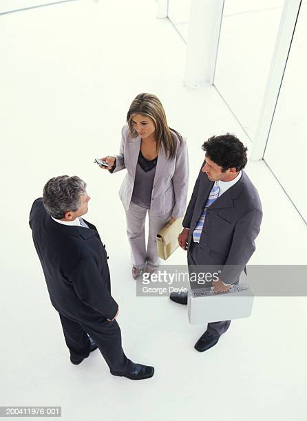 Businessmenand woman talking, elevated view