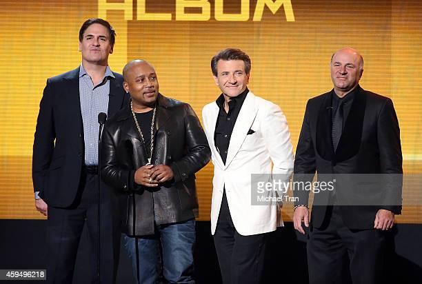 Businessmen/'Shark Tank' cast members Mark Cuban Daymond John Robert Herjavec and Kevin O'Leary speak onstage at 2014 American Music Awards held at...