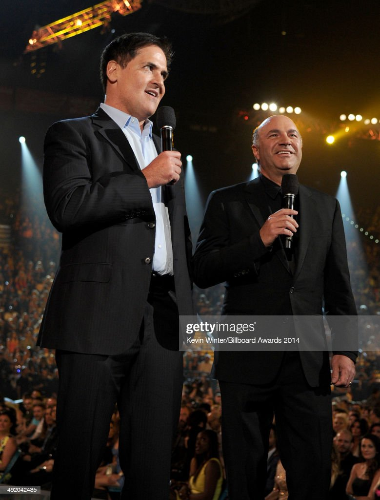Businessmen/TV personalities Mark Cuban and Kevin O'Leary speak onstage during the 2014 Billboard Music Awards at the MGM Grand Garden Arena on May...