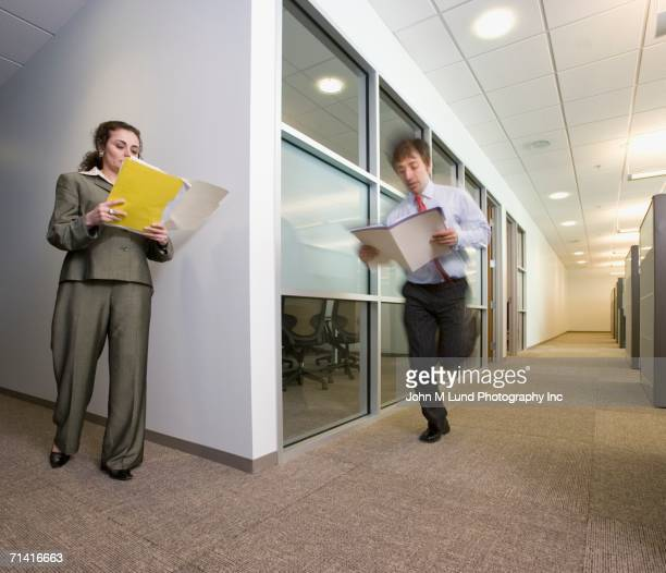 Businesspeople about to crash into each other around the corner