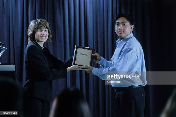 Businesspeople accepting an award