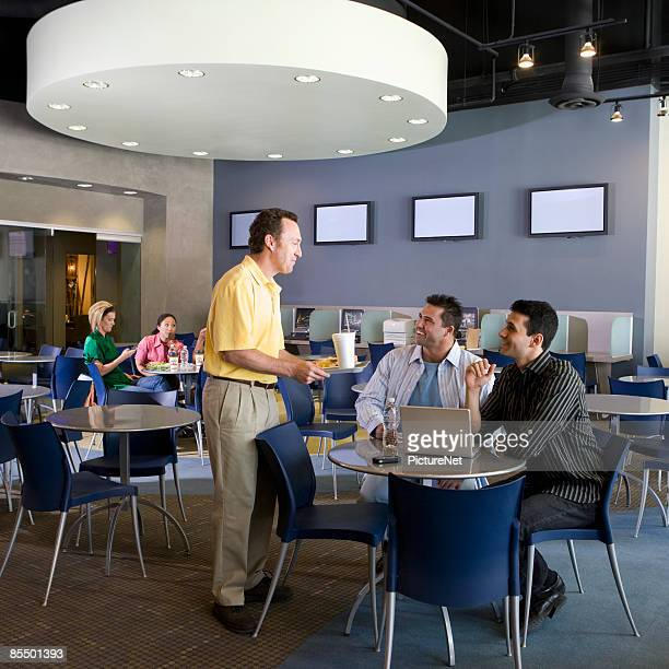 Businesspeople at a Cafeteria Table