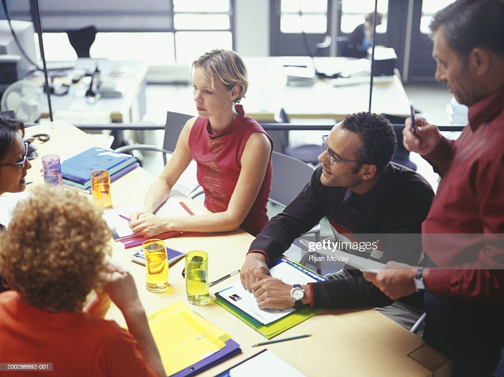 Businesspeople at business meeting in office, elevated view : Stock Photo