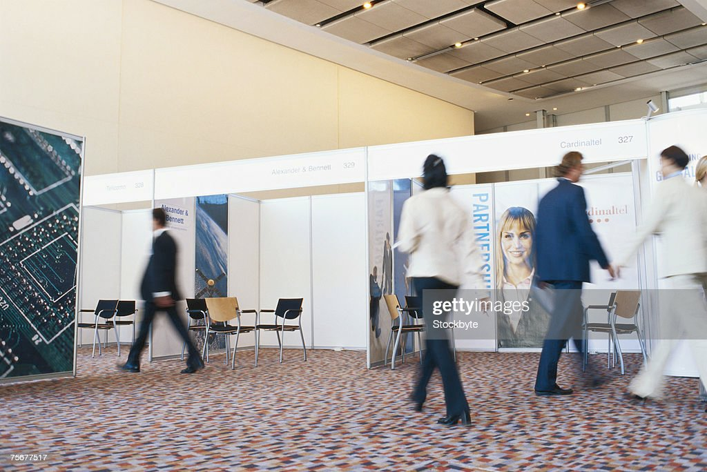 Businesspeople at exhibition