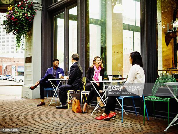 Businesspeople at outdoor tables of cafe