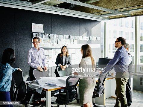 Businesspeople beginning meeting in office