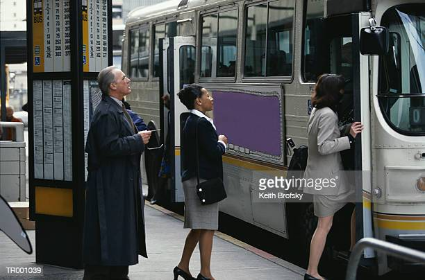 Businesspeople Boarding a Bus