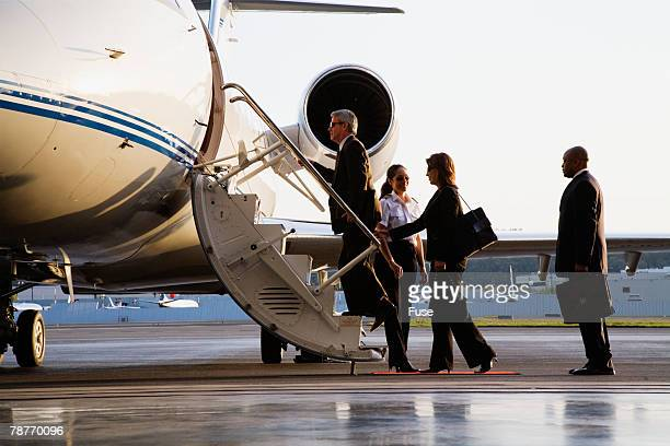 Businesspeople Boarding Executive Jet