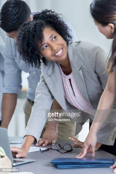 Businesspeople brainstorm ideas together