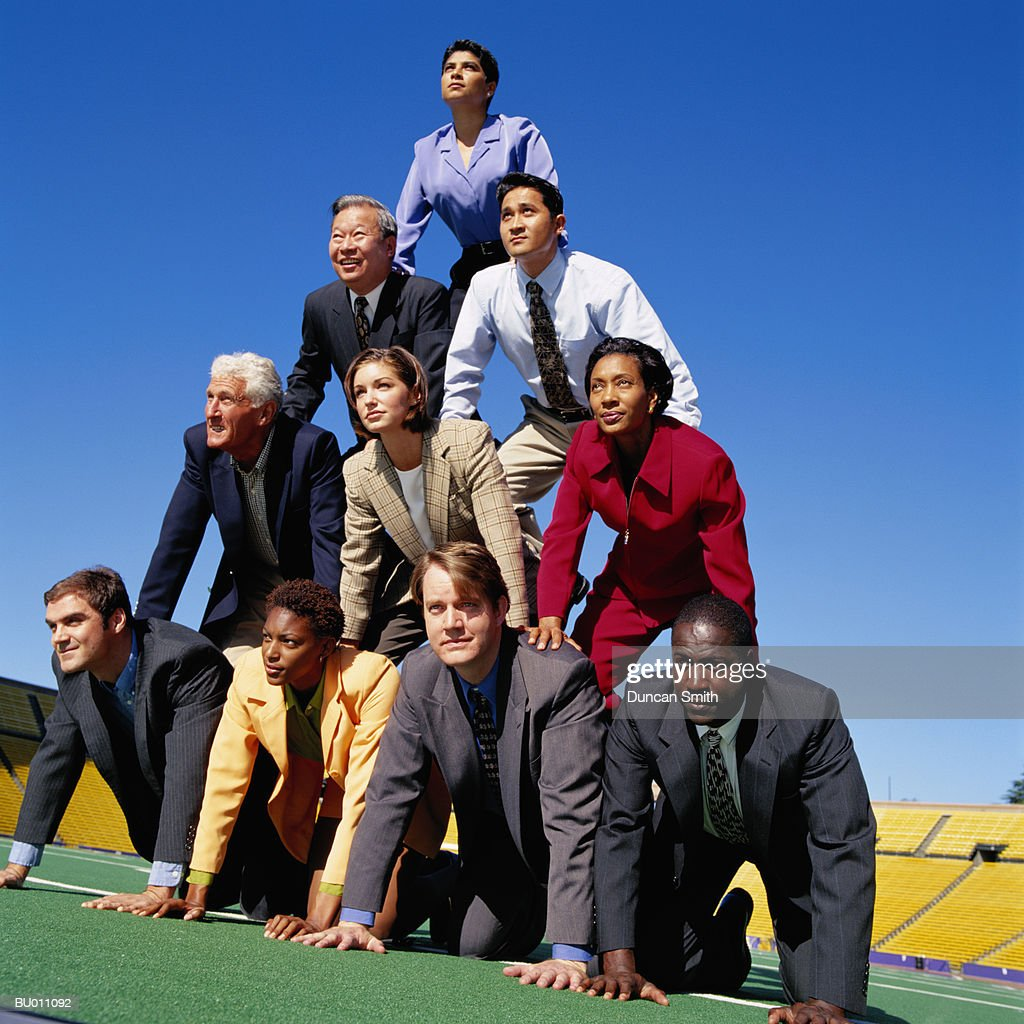 Businesspeople Building a Human Pyramid
