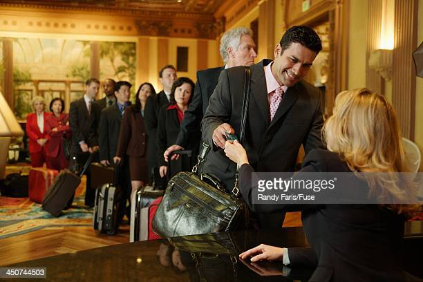 Businesspeople Checking into Hotel
