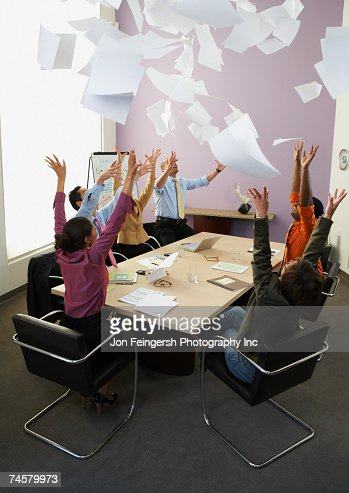 Businesspeople cheering at meeting : Stock Photo