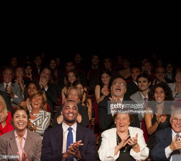 Businesspeople clapping in audience