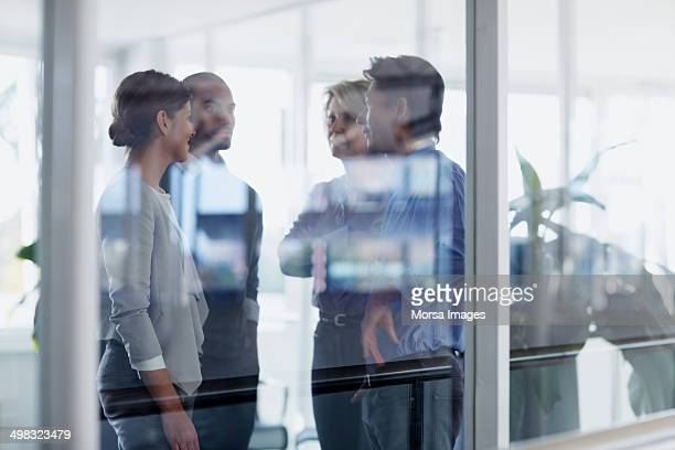 Businesspeople conversing in office