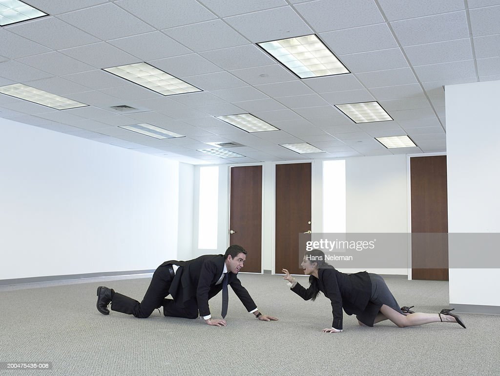 Businesspeople crawling towards each other, side view