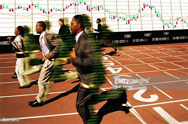Businesspeople Crossing a Finish Line
