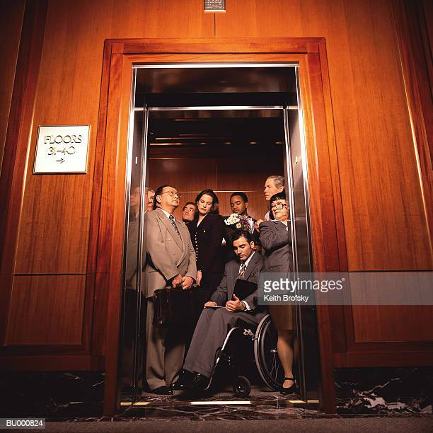 Businesspeople Crowded on an Elevator