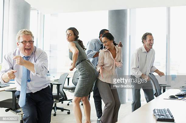 Businesspeople dancing in office
