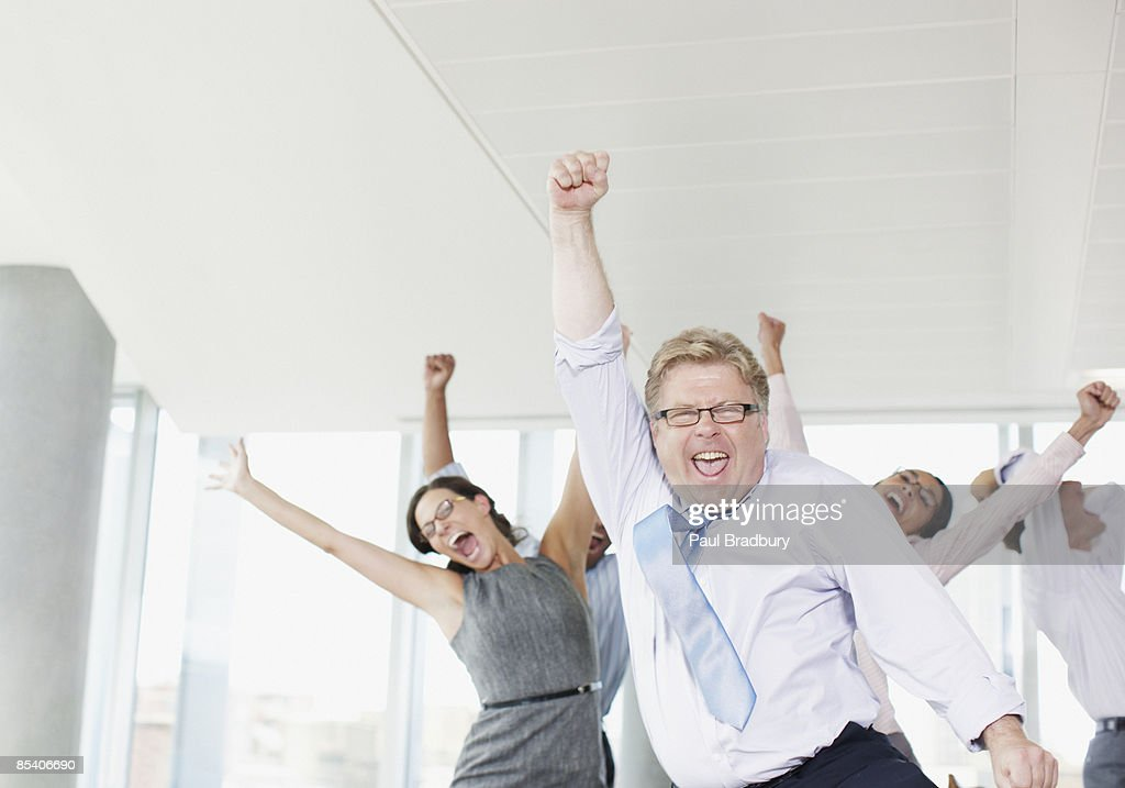 Businesspeople dancing in office : Stock Photo