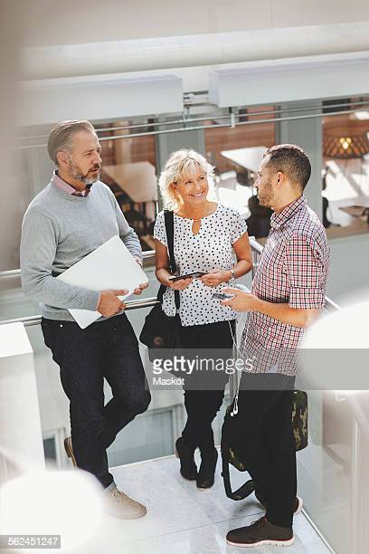 Businesspeople discussing in modern office