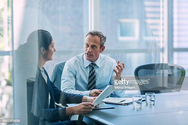 Businesspeople discussing strategy in office