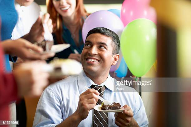 Businesspeople Eating Cake in Office