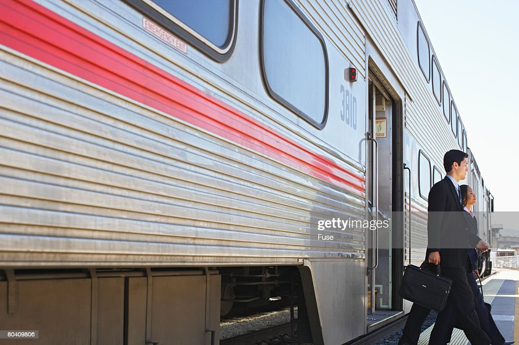 Businesspeople Exiting Commuter Train