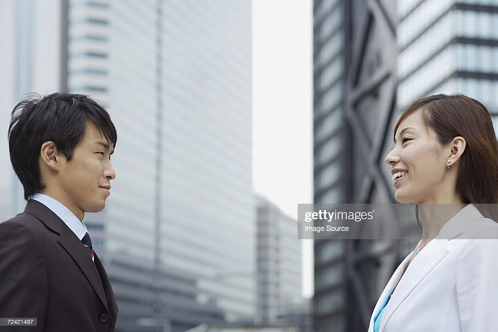 Businesspeople face to face : Stock Photo