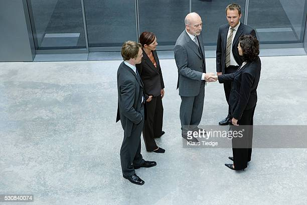 Businesspeople greeting each other