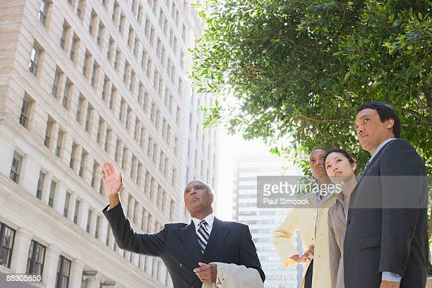 Businesspeople hailing taxi