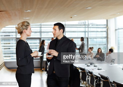Businesspeople Having A Coffee Break At Meeting Stock ...