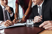 Businesswoman hands signing a document. Businesspeople sign up contract during a meeting in office.