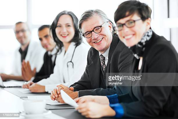 Businesspeople having a meeting with doctors.