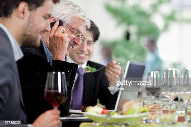 Businesspeople having lunch at restaurant
