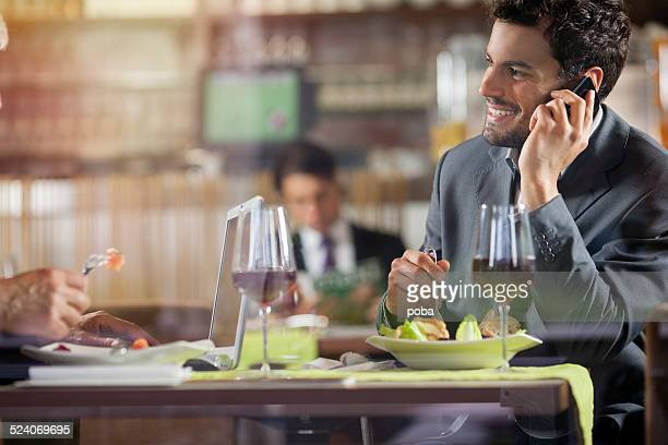 Businesspeople having lunch at the restaurant