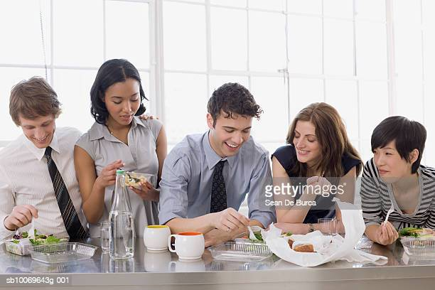 Businesspeople having lunch in office
