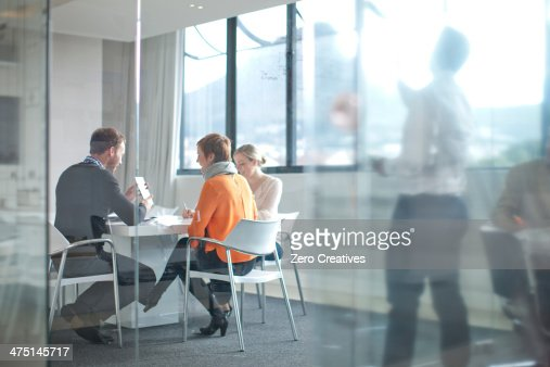 Businesspeople having meeting at conference table