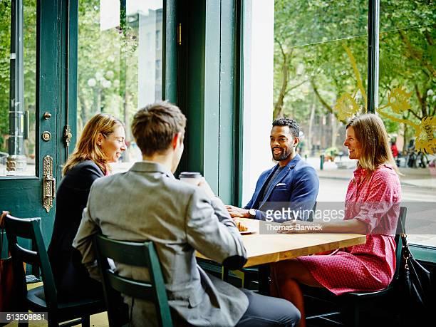 Businesspeople having meeting coffee shop