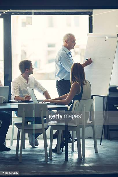 Businesspeople having meeting in office.