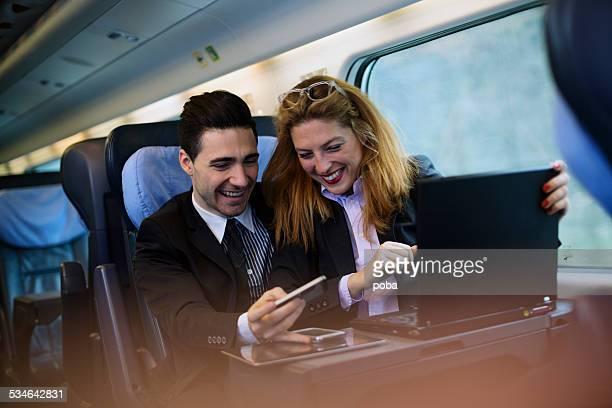 Businesspeople Having Meeting On Train