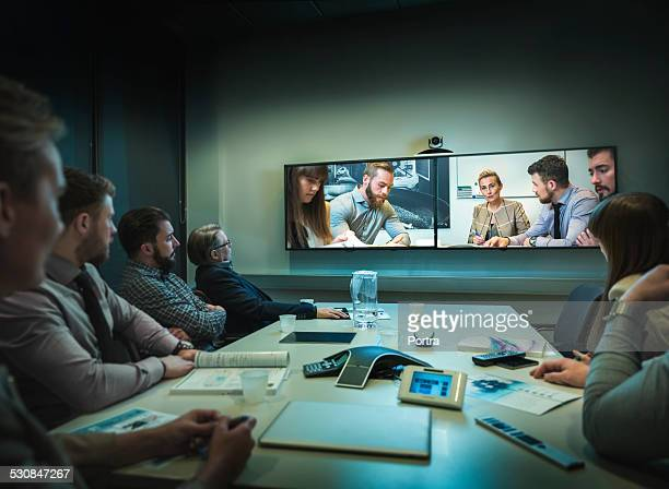 Businesspeople having video conference at office