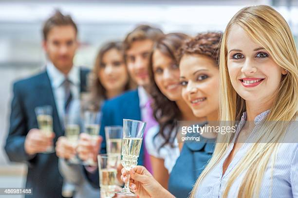 Businesspeople holding champagne glass