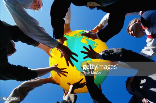 Businesspeople Holding Up a Globe : Stock Photo