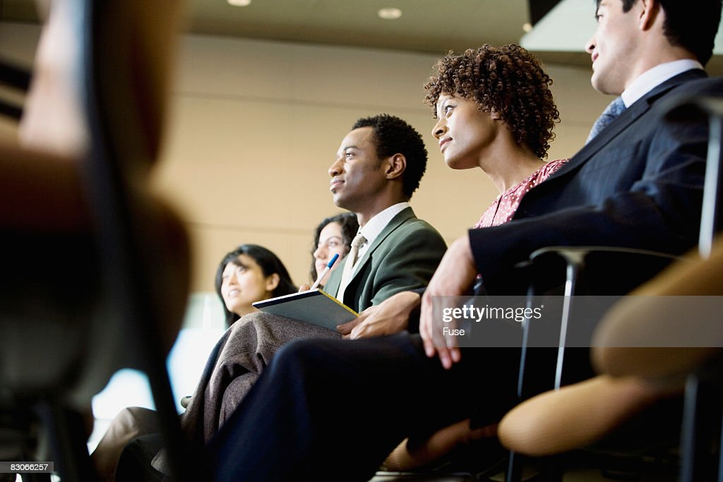Businesspeople in Audience of Conference