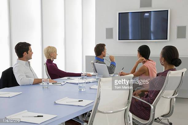 Businesspeople in boardroom with laptop