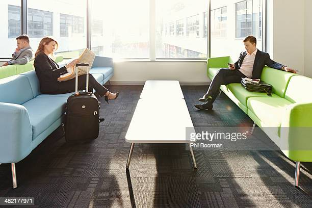 Businesspeople in departure lounge