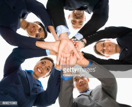 Businesspeople in huddle : Stock Photo